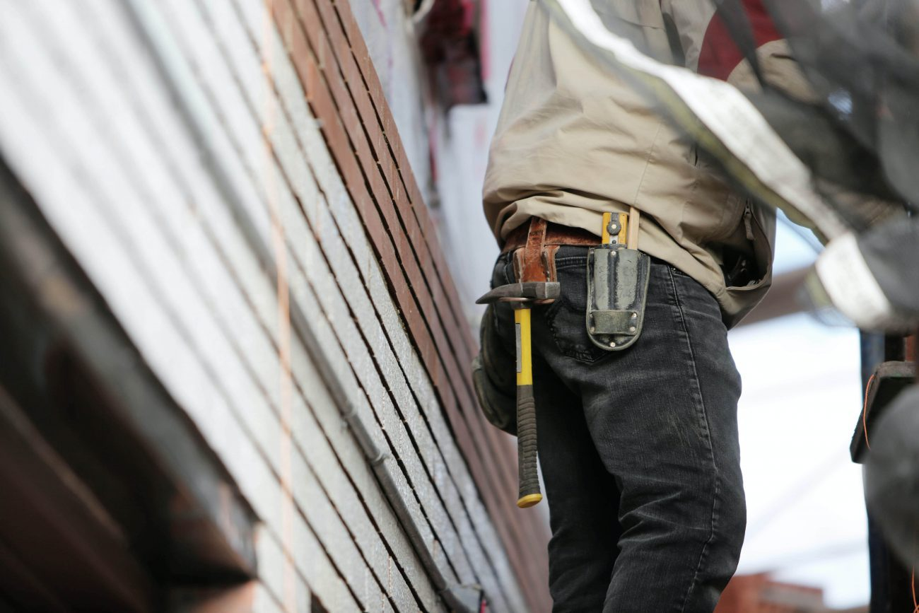 Does home insurance cover tradesmen in my home?